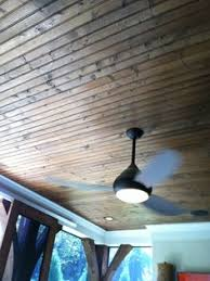 Hardwood Beadboard - awesome screened porch with wood decking and stained beadboard