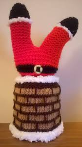 hand knitted father christmas stuck in the chimney gift jar cover
