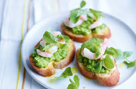 canapes with prawns pea and prawn crostini recipe goodtoknow