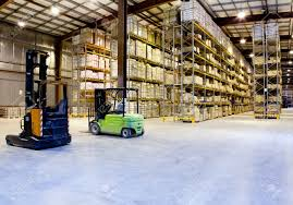 large modern warehouse with forklifts stock photo picture and