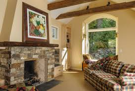 cream wall native wood house design with stone fireplace mantle
