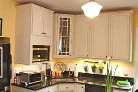 White Chalk Paint Kitchen Cabinets by Brown Paint Wooden Kitchen Cabinet With White Countertop And White