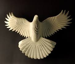 this is a wooden dove carving and i think it is exquisite