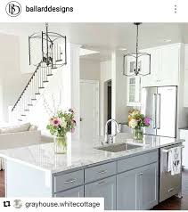 what color kitchen cabinets go with agreeable gray walls the island color is sherwin williams cityscape the wall