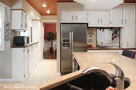 white kitchen cabinets wood trim s kitchen cabinet makeover how to nest for less