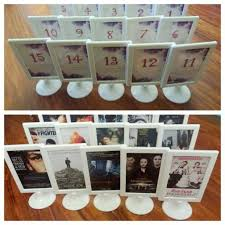 themed table numbers 34 best themed wedding seating plans images on