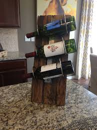 cool free standing wine rack from pallet wood and rolled metal