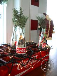 lake paints coca cola bottles with rosemary clippings