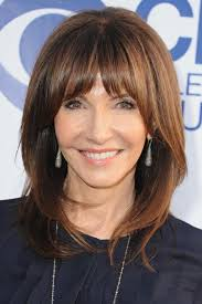 hairstyles with bangs and middle part medium length hairstyles we re loving right now southern living