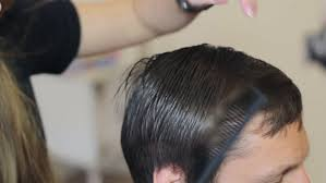 usinghair cls hairdresser using hair clippers barber hands fixing hair man with