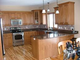 black granite counter oak hickory oak wood kitchen cabinet