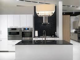 kitchen island with black and white chairs subway tile backsplash