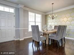contemporary dining room with interior wallpaper chair rail in