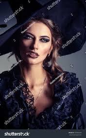 halloween fashion background images portrait gorgeous brunette witch black dress stock photo 376885099