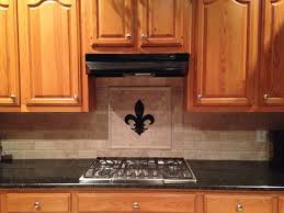travertine backsplash fleur de lis matches granite countertop