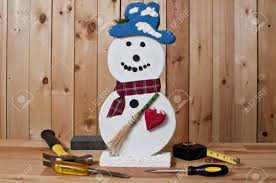 wooden snowman craft wooden snowman and tools on wood background stock