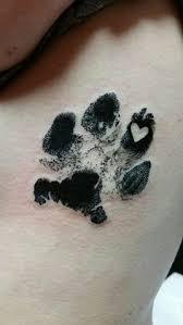 paw print tattoo with a heart tattoo pawprinttatto tats