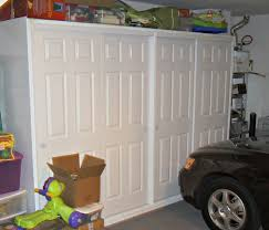 garage cabinets with sliding doors free standing lean to plans build storage buildings diy garage
