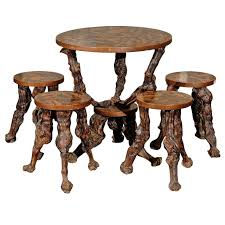 set of european grapevine round table and four accompanying stools