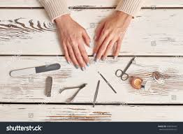 beautiful wellgroomed womens hands tools manicure stock photo