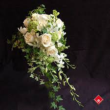 wedding flowers montreal cascading bridal bouquet of white roses orchids and freesias