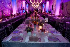 purple flower arrangements for dining room restaurant with candle