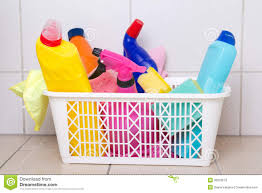 cleaning supplies in plastic box on tiled floor royalty free stock