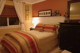 bedroom interior design with peach painted wall combined turquoise