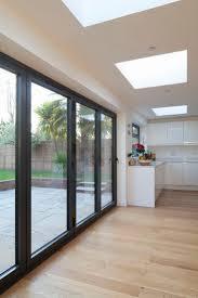 best flat roof design ideas pinterest house rear flat roof extension black aluminium fold doors open plan living