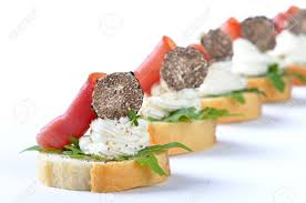 italian truffle cheese deliciuos morsels with cheese ham rocket salad and italian
