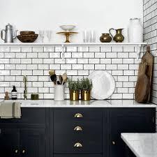 black kitchen cabinets with white subway tile backsplash 19 ways to use subway tile in the kitchen
