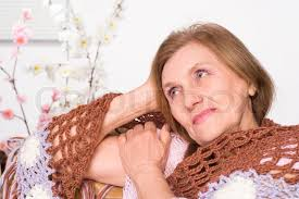 elderly woman clothes a beautiful elderly woman in brown clothes stock photo colourbox