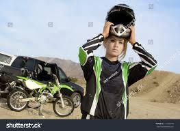 womens motocross helmet young female motocross racer removing helmet stock photo 111905576