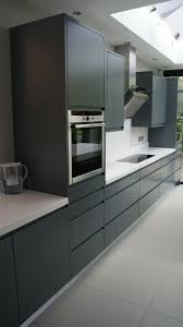 modern handle less grey matt painted bespoke kitchen with white