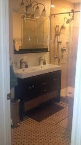 bathroom black hardwood floor towel rails hand shower round