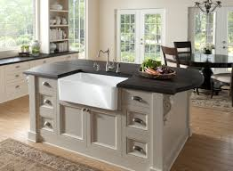 kitchen islands with sink sink apron front sink with black faux countertops kitchen island