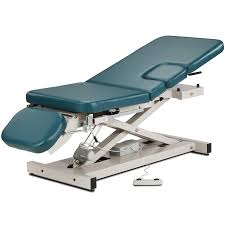 massage table with stirrups clinton open base multi use power imaging table with stirrups