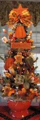 primitive halloween pumpkin baking tree in orange enamel colander