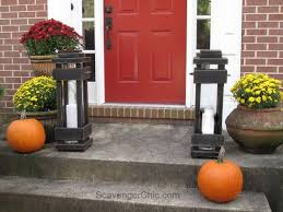 lanterns home decor she put two tall glass vases on her porch now everyone s copying