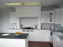 Subway Tile Backsplash In Kitchen Pure White Kitchen With Classic Cabinet Trim Also Ceramic Subway