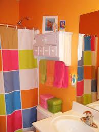 bright walls bathroom in orange and colorful curtain idea