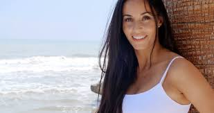 black hair for the beach pretty young woman with long black hair leaning against tree trunk