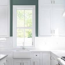 wall tiles for white kitchen cabinets white kitchen with green tiles design ideas