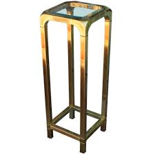 mastercraft brass and glass pedestal or accent table