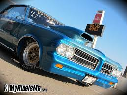1964 pontiac gto speeds up while drag racing myrideisme com