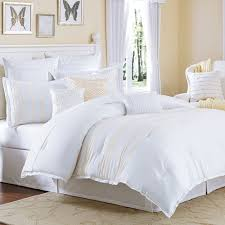 bedroom decorating selection features white lines bedding and