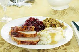 thanksgiving turkey dinner with mashed potatoes and gravy
