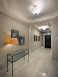 photos hgtv transitional entryway with tray ceiling and marble