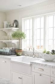 white kitchen cabinets with farm sink white apron sink cottage kitchen molly frey design