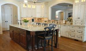 White Kitchen Cabinets With Glaze by Off White Glazed Kitchen Cabinets Dark Island Granite Ties Them
